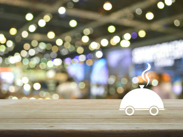 restaurant cloche flat icon on wooden table over city - food logo stock photos and pictures