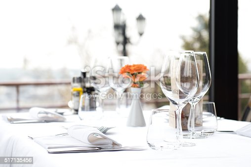 A restaurant dining table & dinner place setting. Restaurant Dinner Table Place Setting, Napkin & Wineglass