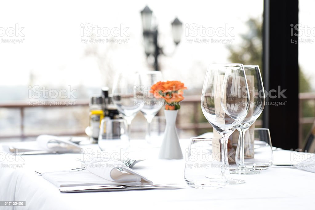 Restaurant Dinner Table Place Setting, Napkin & Wineglass stock photo