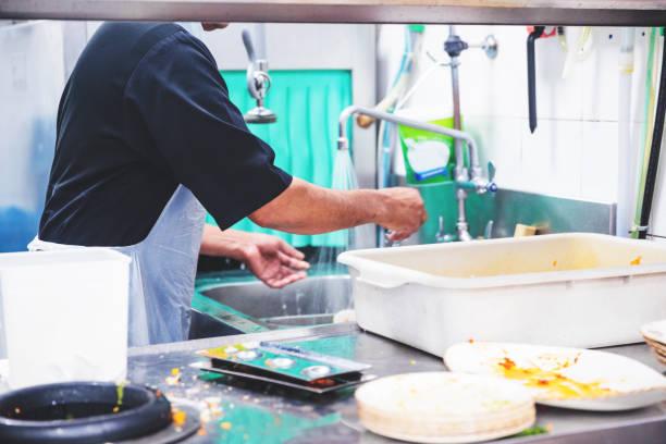 Restaurant Dish Washing Staff at Work stock photo