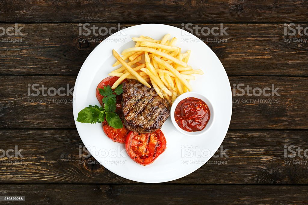 Restaurant food - beef grilled steak with french fries stock photo