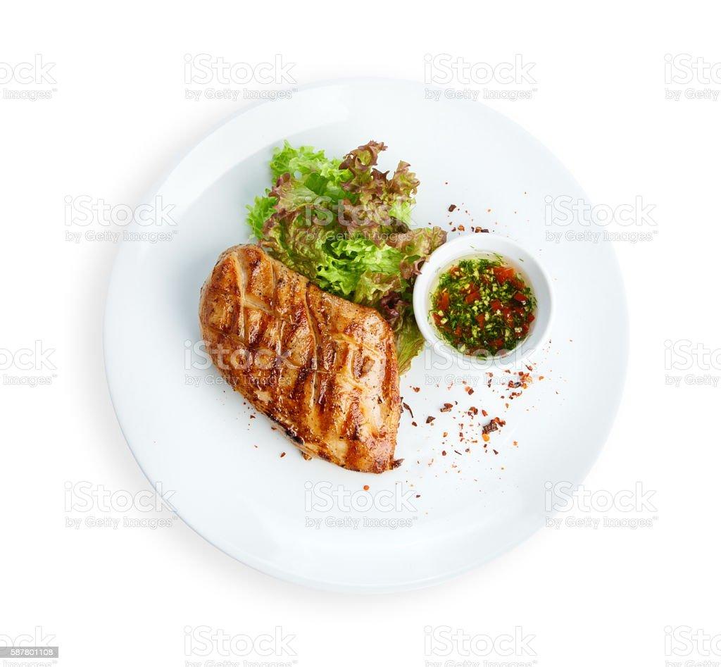 Restaurant food - chicken fillet grilled steak isolated on white...