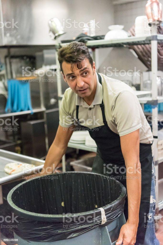 Restaurant kitchen worker stock photo