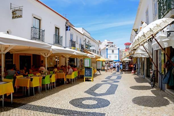restaurant lined street, lagos, portugal. - esplanada portugal imagens e fotografias de stock
