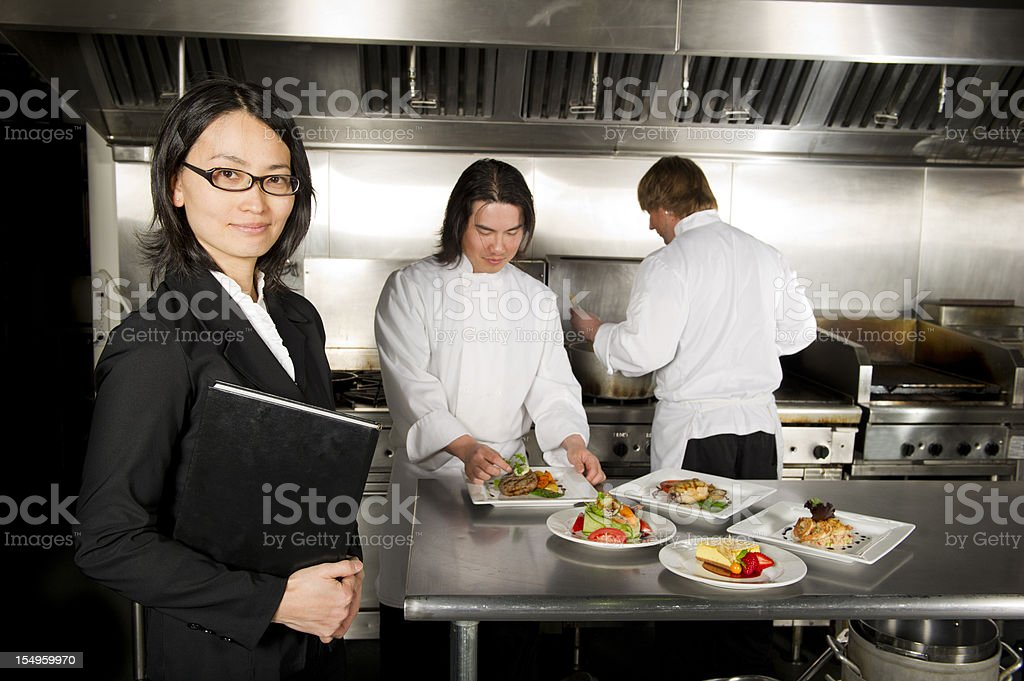 Restaurant manager with professional chefs working royalty-free stock photo