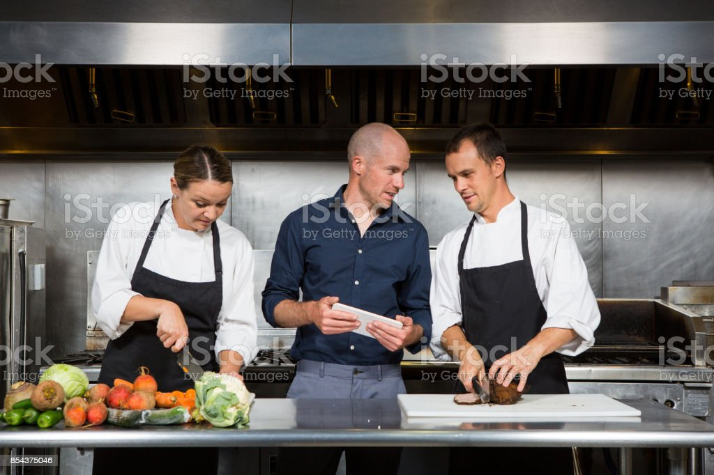 Restaurant manager works with his professional chef's stock photo
