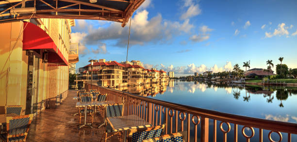 Restaurant on the water along the Village at Venetian Bay Restaurant on the water along the Village at Venetian Bay in Naples, Florida. naples florida stock pictures, royalty-free photos & images
