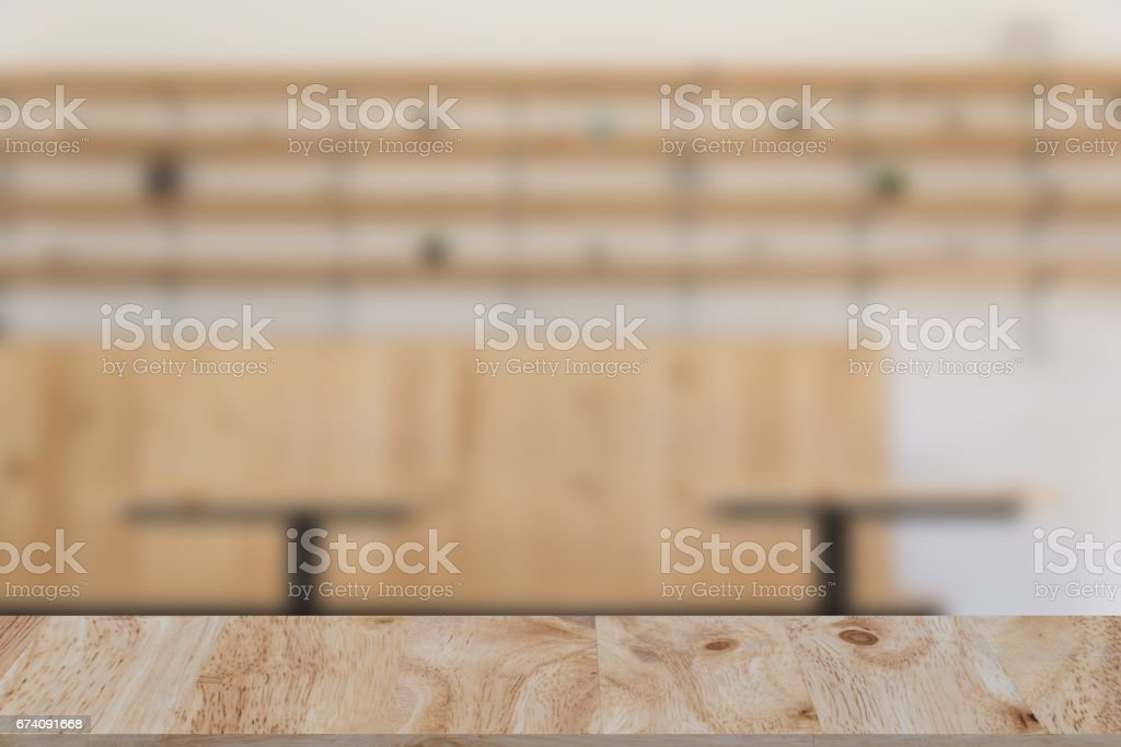restaurant or coffee shop blur background with selected focus wood table for montage or display your product royalty-free stock photo