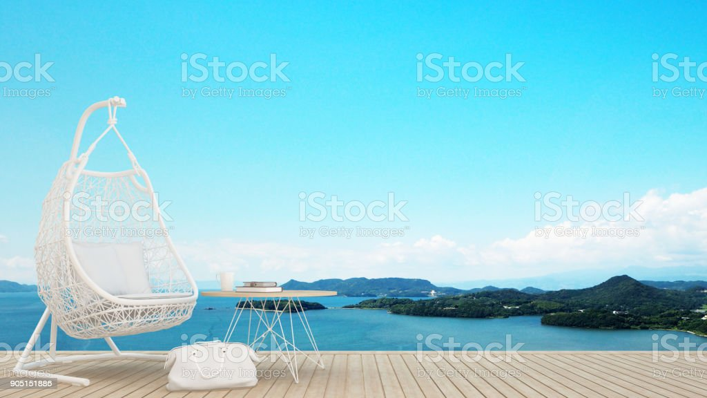 restaurant or lounge in hotel - living area on balcony and sea view - artwork for holiday time - Blur background - 3D Rendering stock photo
