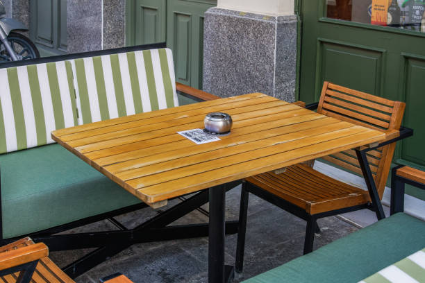 Restaurant outdoor table with menu and social media QR scan barcode after government loosens COVID-19 measures. stock photo