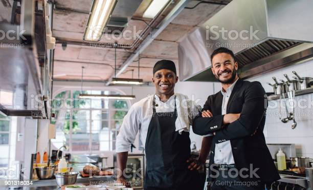 Restaurant owner with chef in kitchen picture id901318034?b=1&k=6&m=901318034&s=612x612&h=7iv1nykob4jwtk9efkihy8evd4gin3bnrg  5h 8ysk=