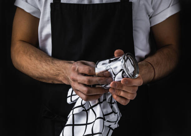 Restaurant personnel Waiter wiping clear glass. Restaurant staff. Service sector. apron stock pictures, royalty-free photos & images