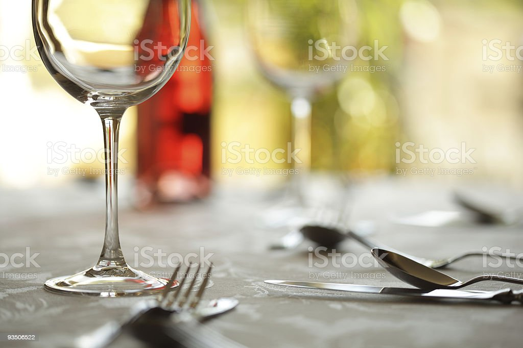 Restaurant place setting and wine glass royalty-free stock photo