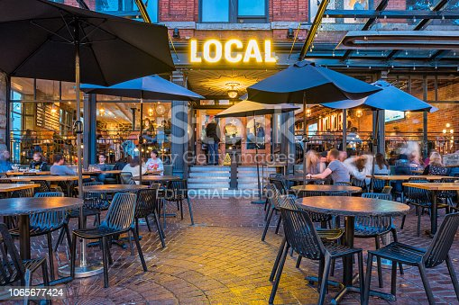 People relax on the patio of a gastropub in Gastown, downtown Vancouver, British Columbia, Canada in the evening.