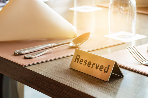 Restaurant reserved table sign Restaurant reserved table sign wildlife reserve stock pictures, royalty-free photos & images