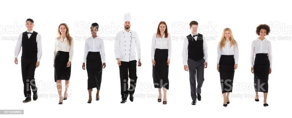 Restaurant Staff Walking Against White Background stock photo