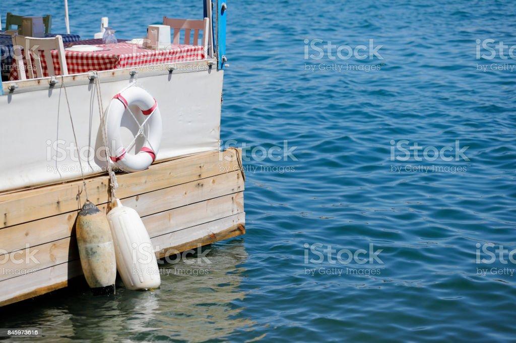 Restaurant table at the beach of Aegean Sea - foto stock