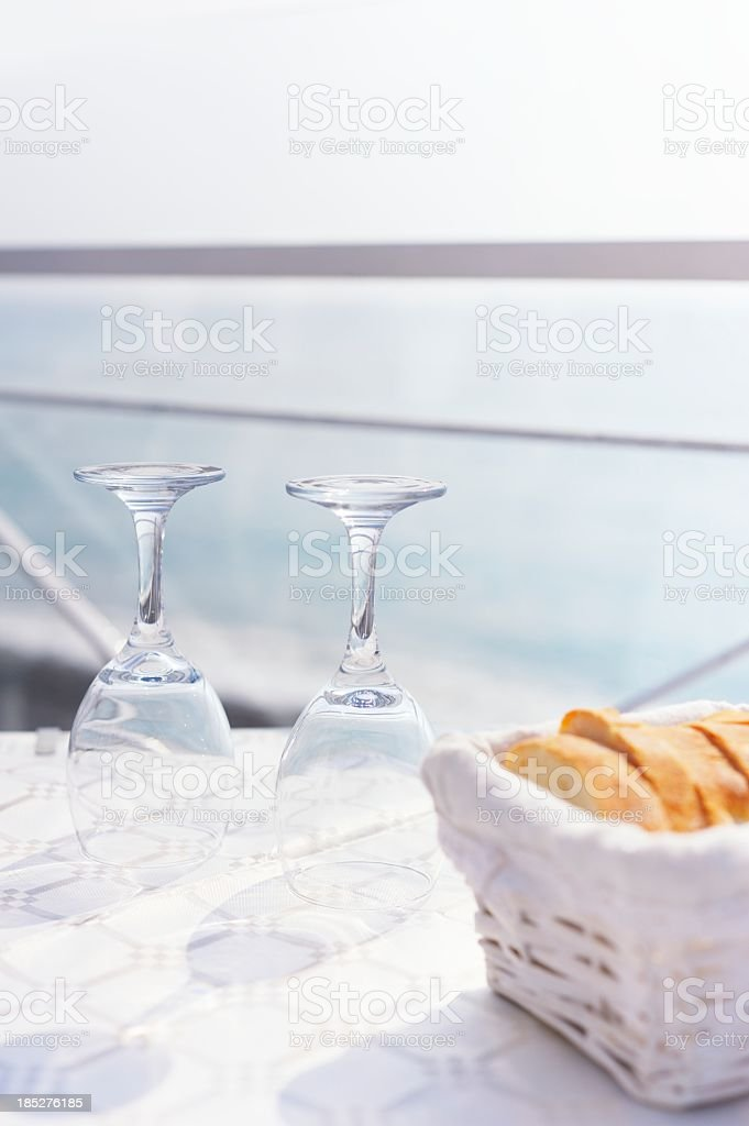 Restaurant Table by the Sea in Summer stock photo