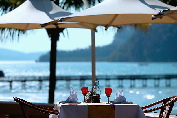 Restaurant table by the sea stock photo