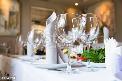 istock Restaurant table with glasses and napkins 611091408