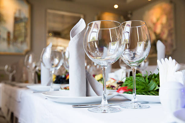 Restaurant table with glasses and napkins stock photo