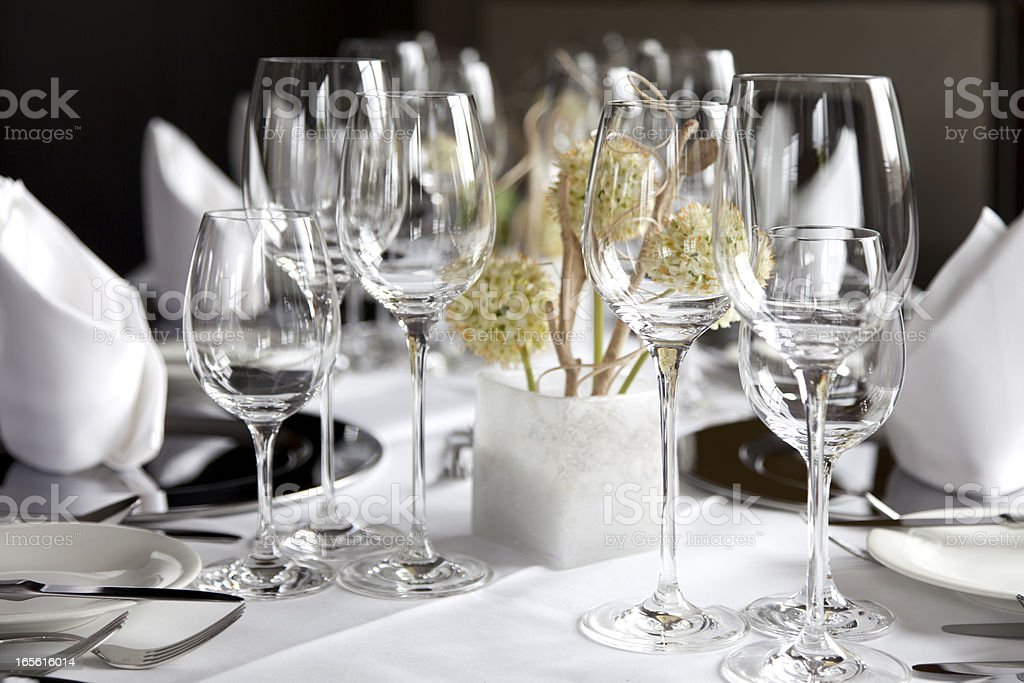 Restaurant table with wine glasses and napkins royalty-free stock photo