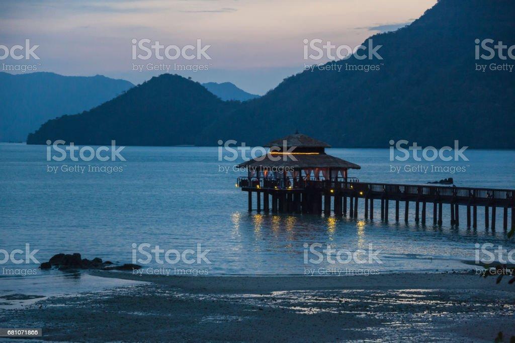 Restaurant terrace on piles near the coastline stock photo