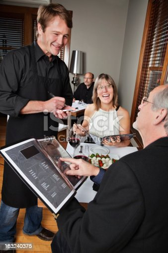 635812444 istock photo Restaurant Waiter Taking Order From Couple on a Date 183240375