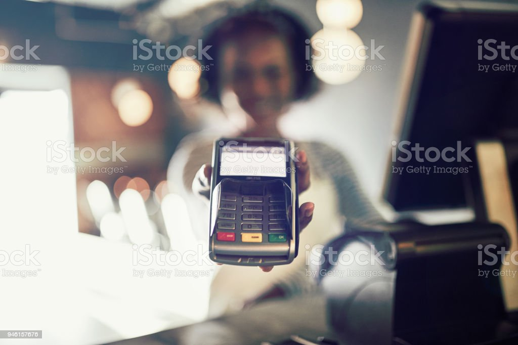 Restaurant waitress holding an electronic card payment machine - Royalty-free Adult Stock Photo