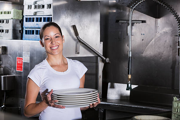 restaurant worker in kitchen - commercial dishwasher stock photos and pictures