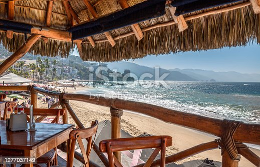 istock Restaurants and cafes with ocean views on Playa De Los Muertos beach and pier close to famous Puerto Vallarta Malecon, the city largest public beach 1277037149