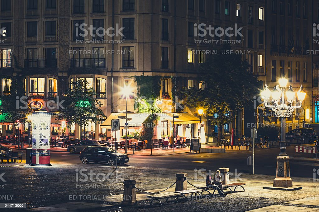 Restaurants at the Gendarmenmarkt at night in Berlin, Germany stock photo