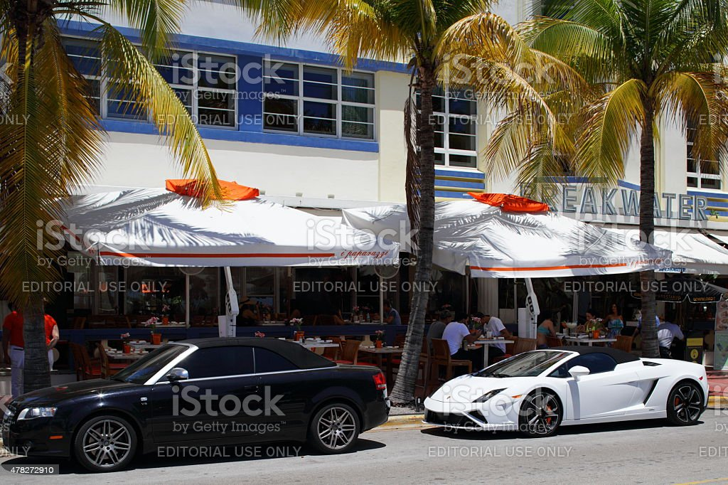 Restaurants On Ocean Drive And Luxury Cars Stock Photo
