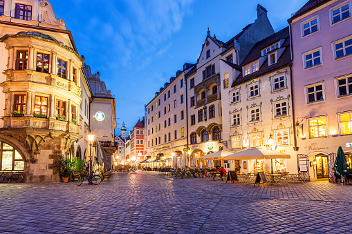 Stock photograph of restaurant patios on Platzl square in downtown Munich Germany