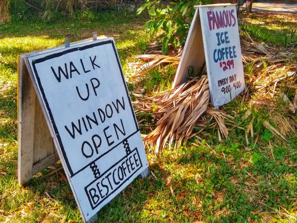 Restaurants signs outside for walk up delivery stock photo