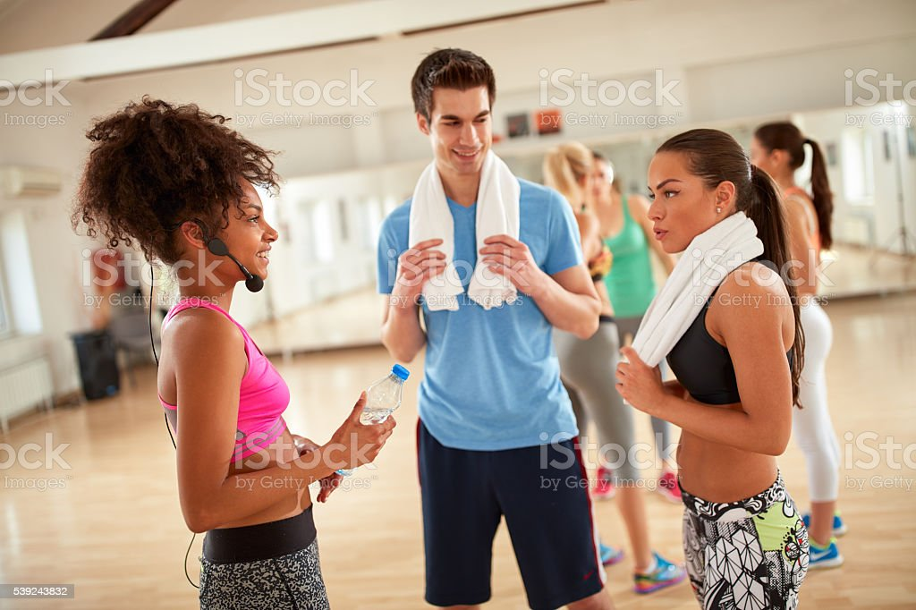 Resting and refreshing after training in fitness center royalty-free stock photo
