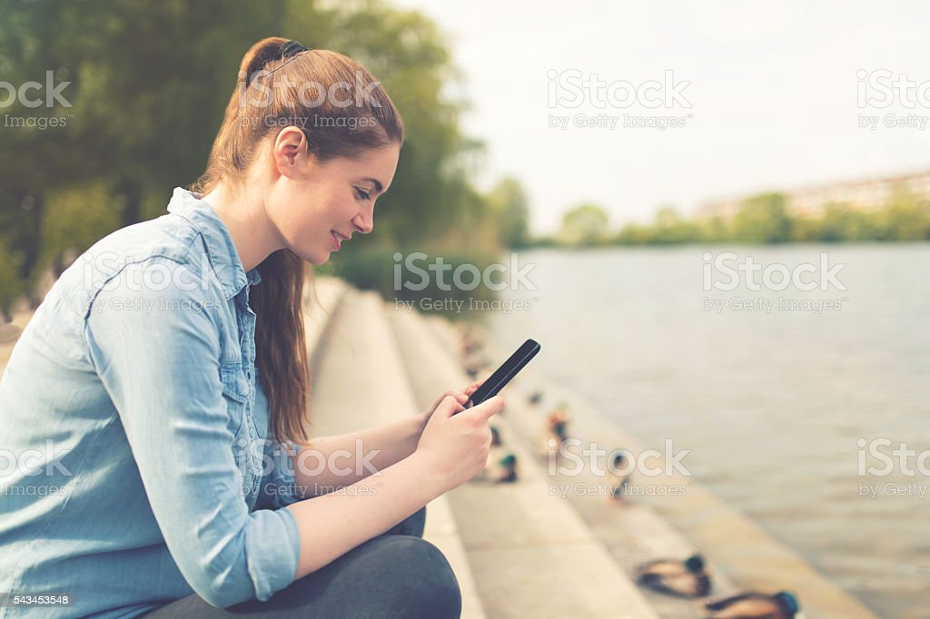 Resting And Texting stock photo