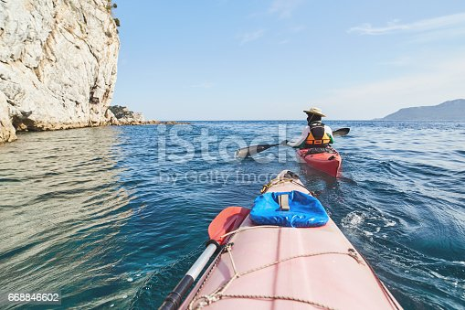 istock Resting at sea with sea kayak 668846602