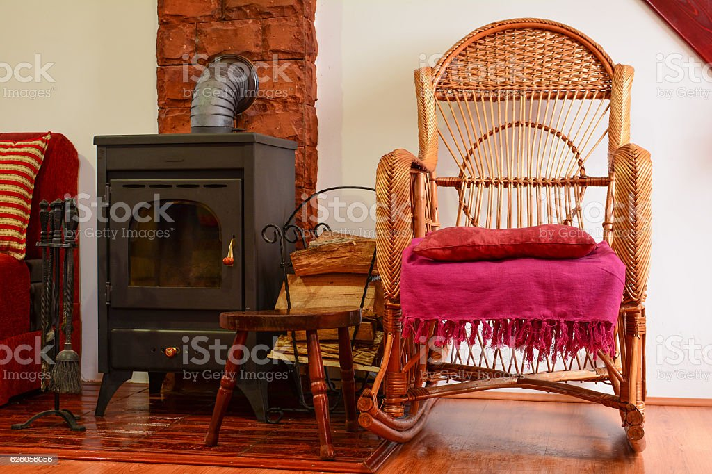 Resting corner with wicker chair stock photo