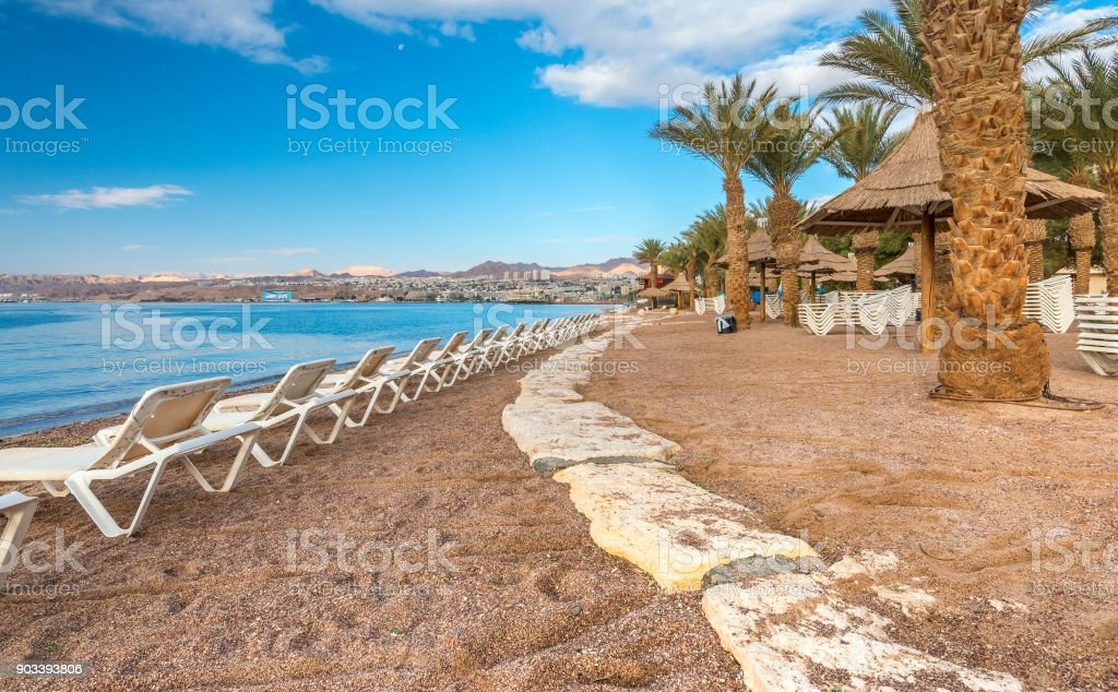 Resting facilities at the central public beach of Eilat stock photo