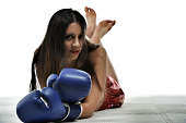 Female kickboxer resting.