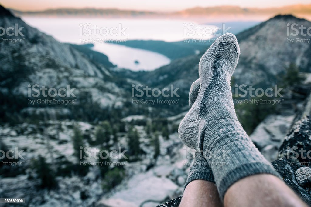 Resting in socks after a long hike in the mountains - foto de stock