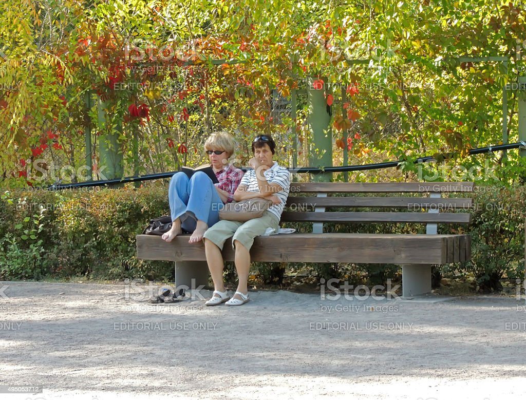 Resting on a park bench stock photo