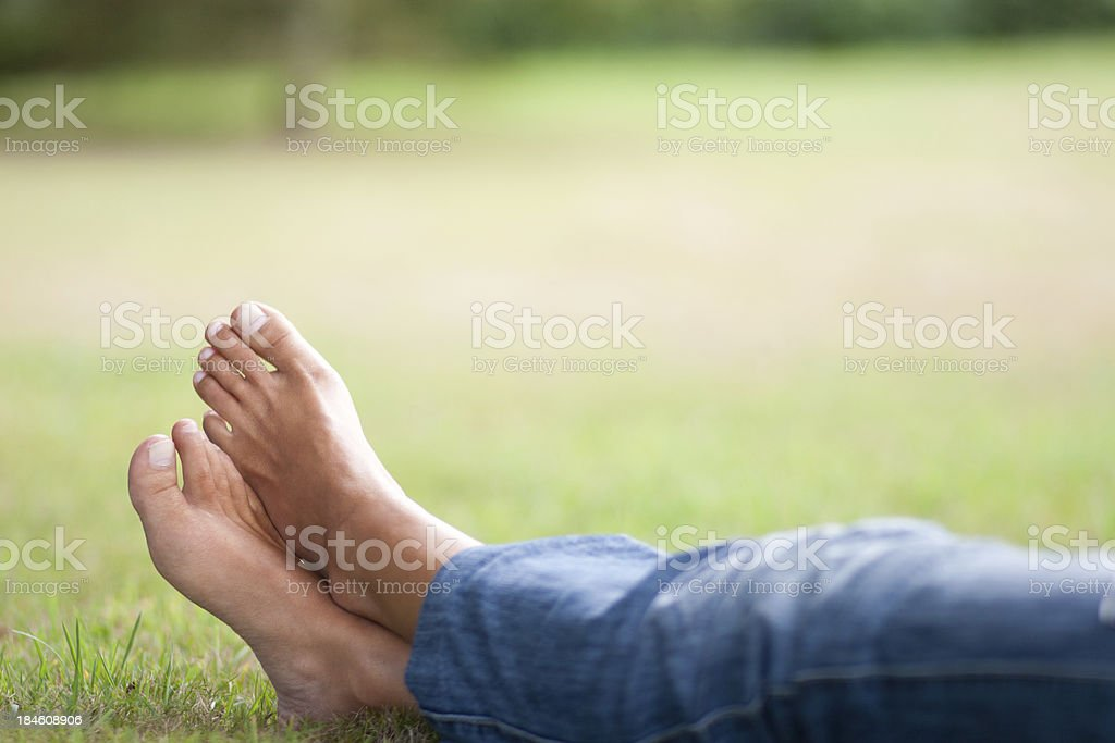 Resting on the grass. Feet stock photo