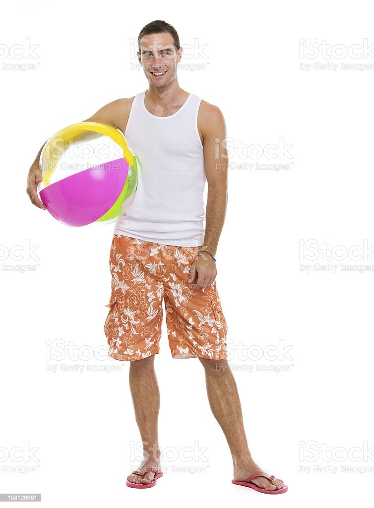 Resting on vacation smiling young man with beach ball stock photo