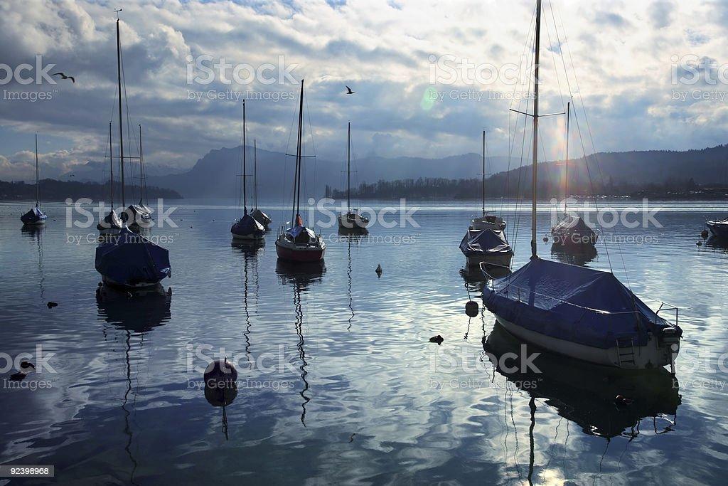 Resting sailboats at dusk royalty-free stock photo