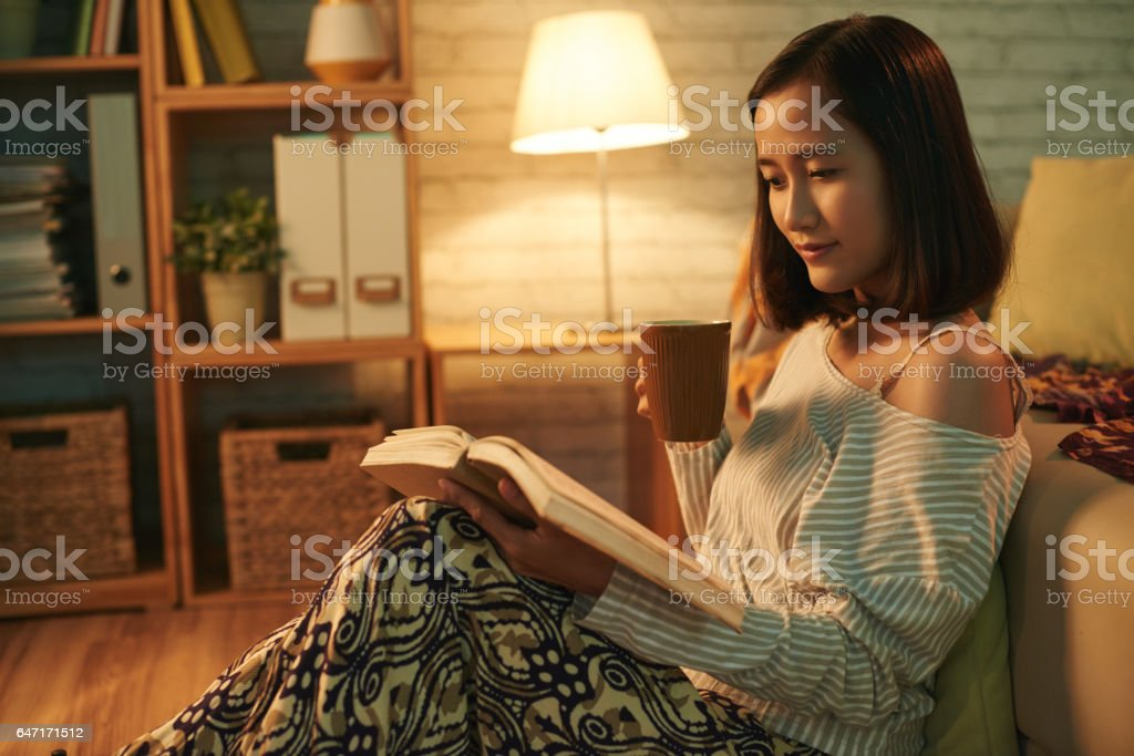 Resting with book stock photo