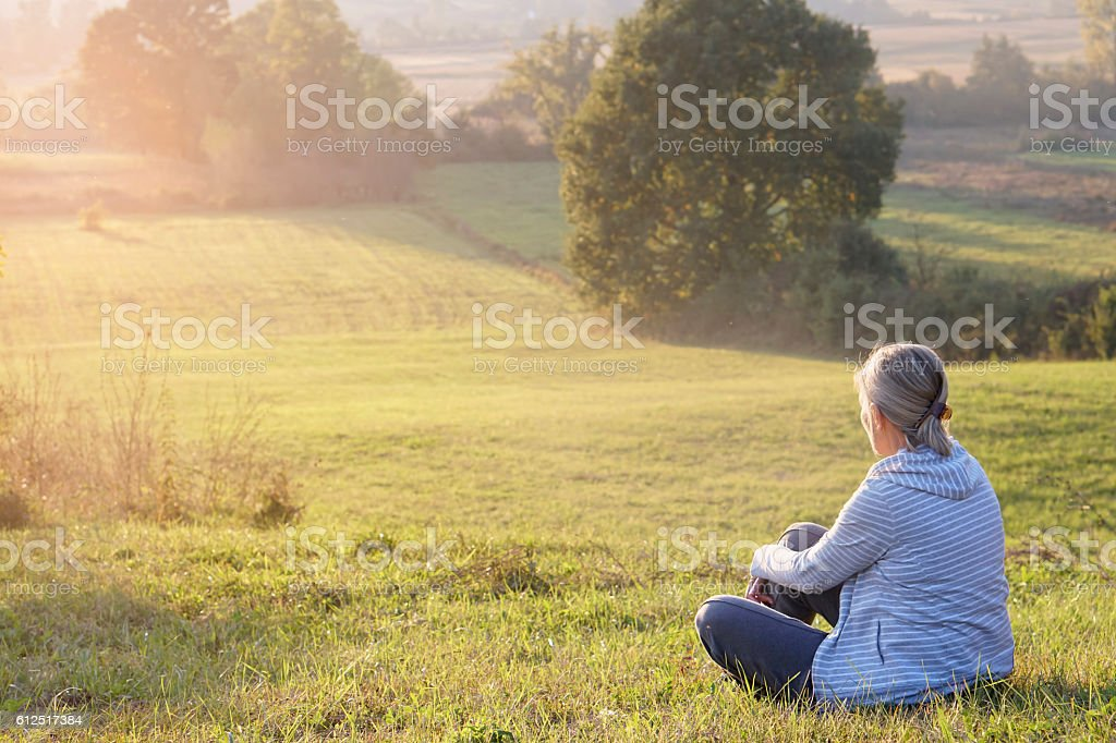 Resting woman in nature stock photo