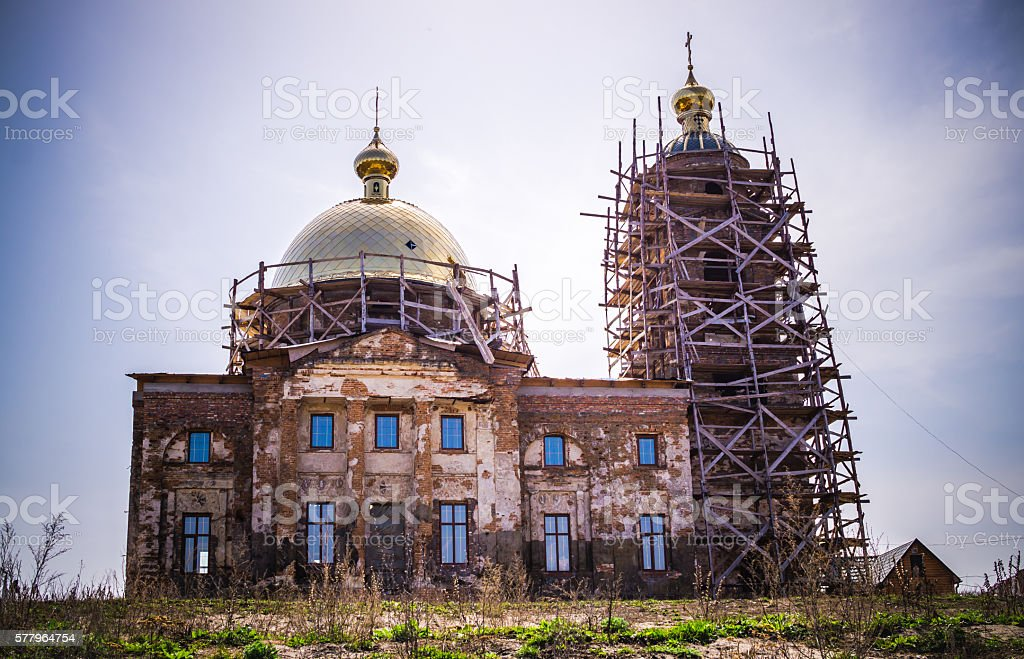 Restoration of the old Orthodox Church. The power of faith stock photo