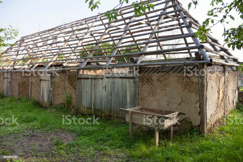 Restoration of the old wattle and daub house stock photo